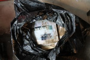 Flood Damaged Albums in Garbage Bag, Cleaning wet photos, Cleaning Wet Albums